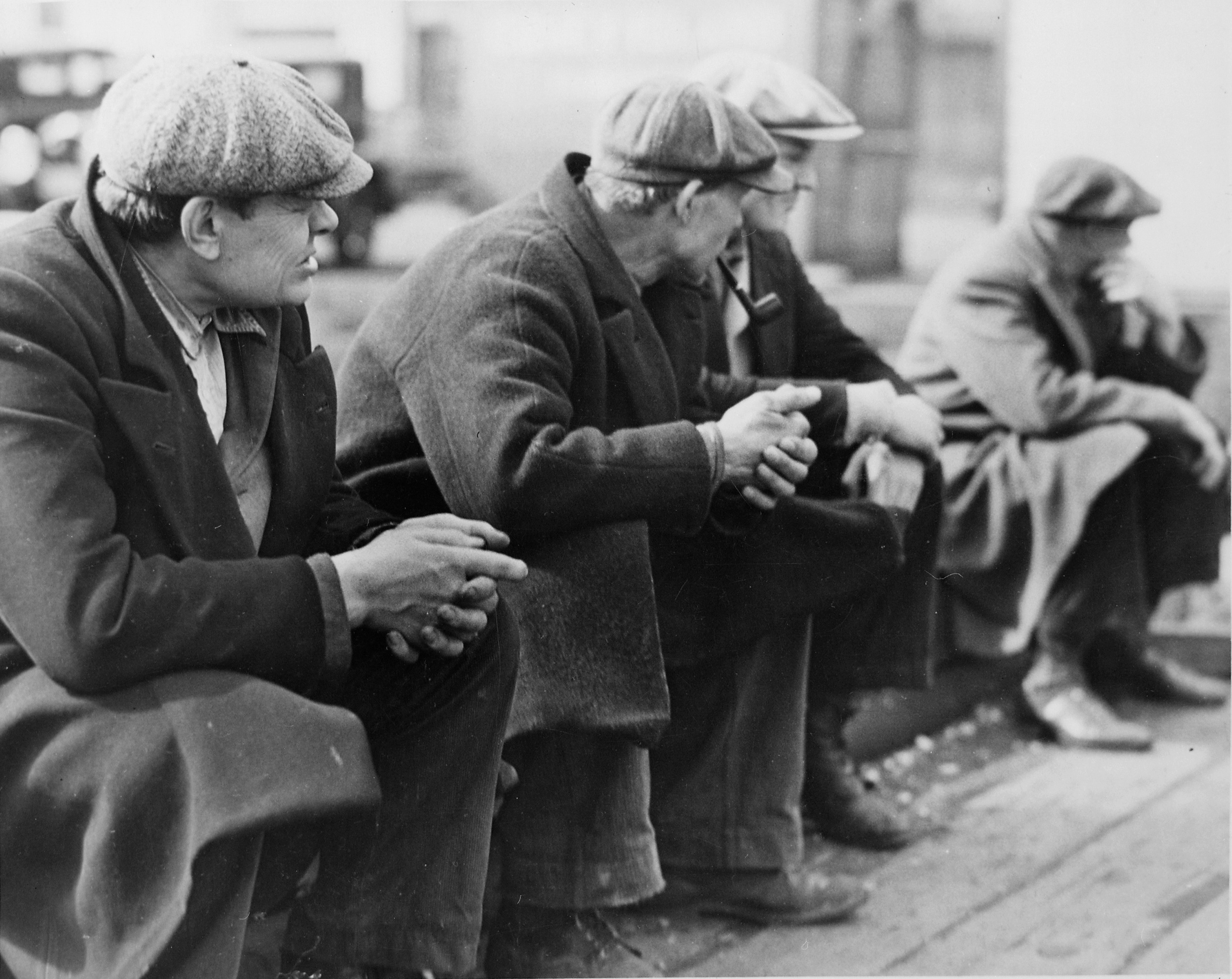 Row of men at the New York City docks out of work during the depression, 1934. U.S. National Archives' Local Identifier: 69-R-1L-3
